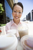 Happy Business Woman On A Break. Portrait of happy Asian business woman on a break with refreshment Royalty Free Stock Images