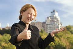 Happy business woman broker shows real estate Royalty Free Stock Image