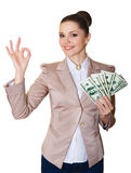 Happy business woman with a bundle of dollars. Isolated on white Stock Image