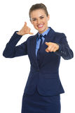 Happy business woman calling with hand gesture Royalty Free Stock Image