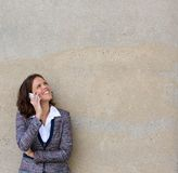 Happy business woman calling by mobile phone Royalty Free Stock Image