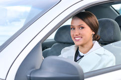 Happy business woman in a car Royalty Free Stock Image