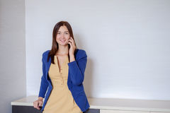 Happy Business Woman in casual clothes Calling on Phone in office Stock Photos