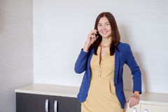 Happy Business Woman in casual clothes Calling on Phone in office Royalty Free Stock Photo