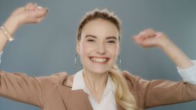 Happy business woman celebrating success. Excited winner celebrating victory stock footage