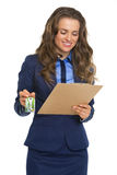 Happy business woman with clipboard and keys Royalty Free Stock Image