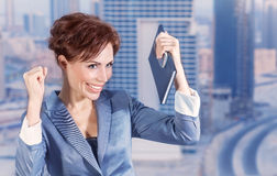 Happy business woman. Closeup portrait of attractive happy business woman on city background, successful career, done deal, executive manager, business and Royalty Free Stock Photo
