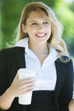Happy business woman with coffee Royalty Free Stock Photography
