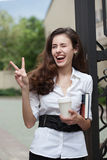 Happy business woman with coffee and notebook Stock Image