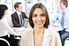 Happy business woman with colleagues Royalty Free Stock Photos