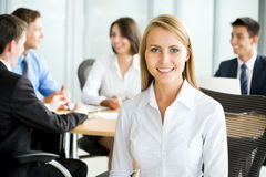 Happy business woman with colleagues Royalty Free Stock Images