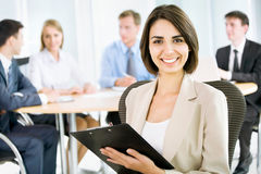 Happy business woman with colleagues Stock Photos