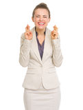 Happy business woman with crossed fingers Royalty Free Stock Image
