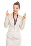 Happy business woman with crossed fingers Royalty Free Stock Images
