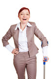 Happy business woman with crutches Stock Photos