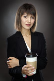 Happy business woman with cup Stock Photo