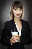 Happy business woman with cup Royalty Free Stock Photos