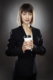 Happy business woman with cup Royalty Free Stock Image