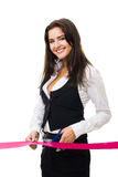 Happy business woman cutting red ribbon Royalty Free Stock Images