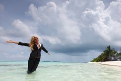 Happy business woman on the ocean coast Stock Photography