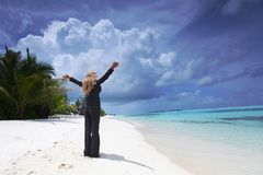 Happy business woman on the ocean coast Stock Images