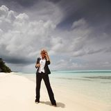 Happy business woman on the ocean coast Stock Photos