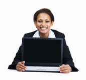 Happy business woman displaying a laptop on white Royalty Free Stock Photography