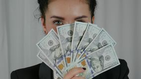 Happy Business Woman Displaying a Spread of Cash royalty free stock photo