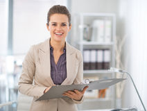 Happy business woman with documents in office Stock Photography