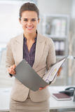 Happy business woman with documents in office Stock Photos
