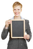 Happy business woman with empty blackboard Royalty Free Stock Images