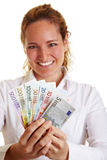 Happy business woman with Euro Royalty Free Stock Images