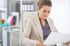Happy business woman examining documents Royalty Free Stock Images