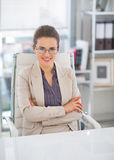 Happy business woman with eyeglasses in office Stock Image