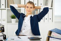 Happy business woman or female accountant having some minutes for coffee and pleasure at working place.  stock photo