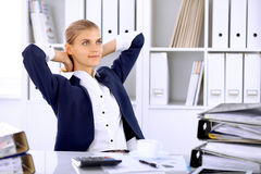 Happy business woman or female accountant having some minutes for time off and pleasure at working place.  stock image