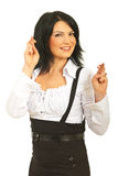 Happy business woman with fingers crossed Royalty Free Stock Photos