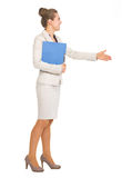 Happy business woman with folder stretching hand for handshake Stock Images