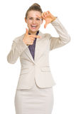 Happy business woman framing with hands Stock Photos