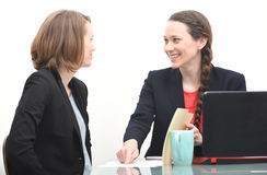 Happy business woman getting instructions from her boss Royalty Free Stock Images