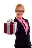 Happy business woman with gift Royalty Free Stock Photos