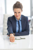 Happy business woman giving money pack Royalty Free Stock Image