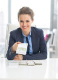 Happy business woman giving money packs Stock Photo