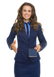 Happy business woman giving passport. And stretching hand for handshake Royalty Free Stock Photography