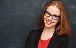 Happy business woman with glasses from blank blackboard Royalty Free Stock Photo