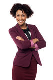 Happy business woman with hands folded. Young african businesswoman with arms folded royalty free stock photos