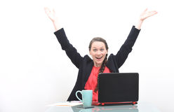 Happy business woman with hands raised in the air Stock Photos