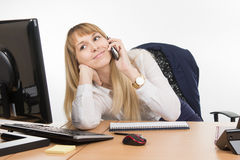 Happy business woman having fun talking on a cell phone in the office Stock Photos