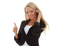 Happy business woman with headset. Happy young business woman with headset on a white background. Operator of support service Stock Image