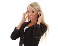 Happy business woman with headset. Happy young business woman with headset on a white background. Operator of support service Stock Photography